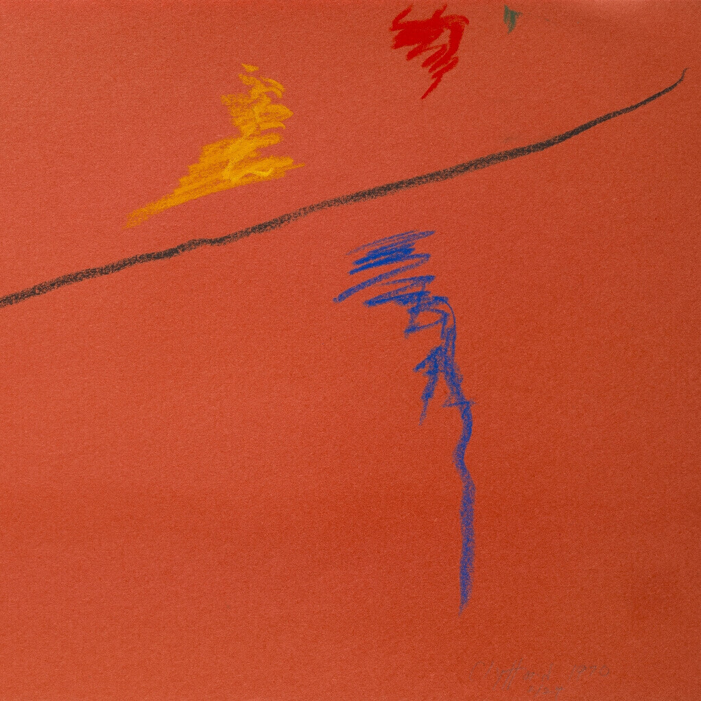 Orange construction paper with streaks of black, blue, yellow and red pastel